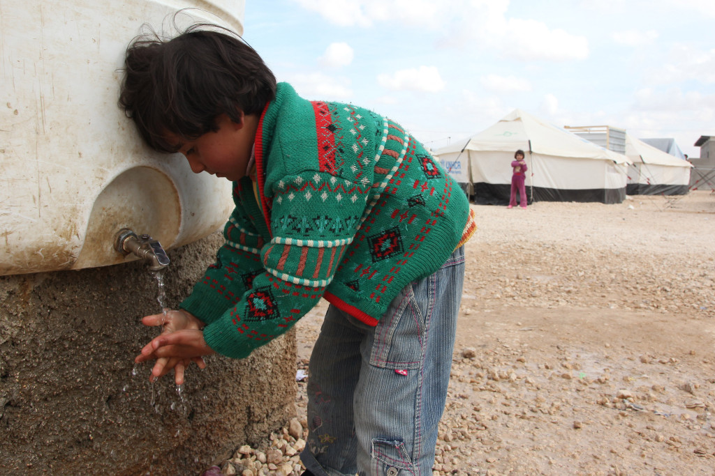 Syrian girl wash her hands in the Zaatari refugee camp for syrian in mafraq , jordan on February 19, 2013